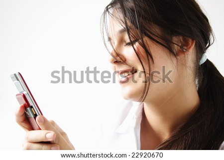 Girl sending an sms dressed in white isolated. - stock photo