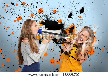 Girl shouting at another covering her ears through megaphone on blue background with orange and black paint splashes - stock photo