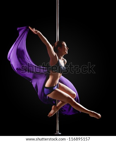 girl show gymnastic exercise with pole dance - stock photo