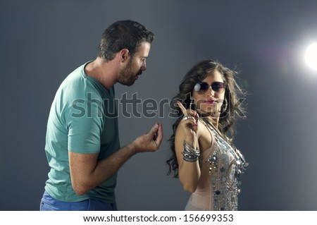 Girl showing arrogance to a guy pleasing her  - stock photo