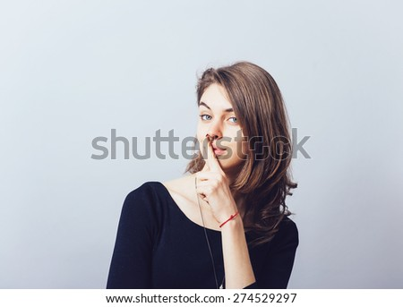 girl showing quietly - stock photo