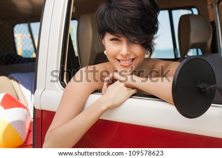 girl showing the language in car near the beach - outdoors - stock photo