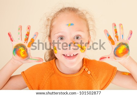 Girl Shows hand painted - stock photo