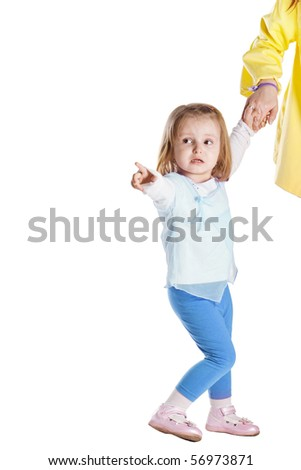 girl shows her mother left - stock photo