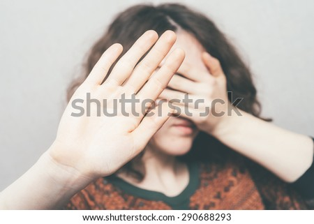 Girl shows stop - stock photo