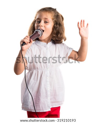 Girl singing with microphone - stock photo