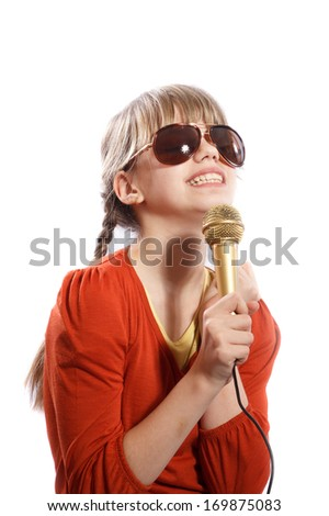 girl sings emotionally into the microphone on a white background - stock photo