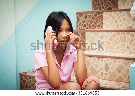girl sitting alone and cry  at staircase in the park - stock photo