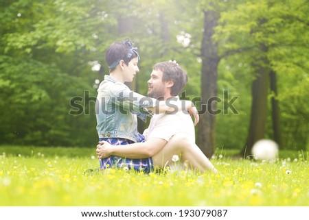 girl sitting and hugging her boyfriend. - stock photo