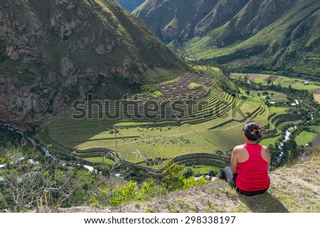 Girl sitting at Pattallacta, Inca ruins of agricultural center,  - stock photo