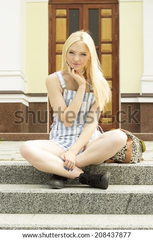 girl sitting on the stairs - stock photo