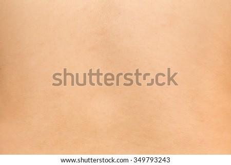 girl skin, human white asian teen skin with pore detail selective focus on center. - stock photo