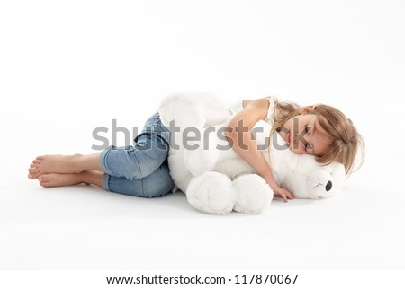 Girl sleeping with big teddy - stock photo