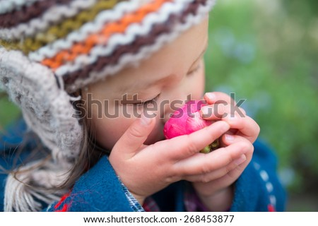 Girl smell the fragrance of camellia flowers - stock photo
