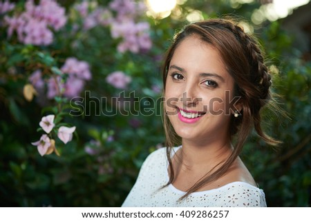 girl smile outside with sunlight on behind her - stock photo