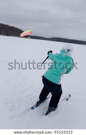 Girl snow kiting - stock photo