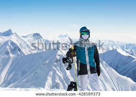 Girl snowboarder on fresh white snow on ski slope on Sunny winter day  - stock photo