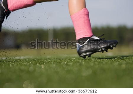 girl soccer player running - stock photo