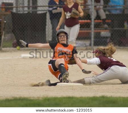 girl softball player sliding into 2nd base - stock photo
