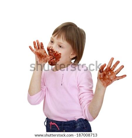 Girl soiled in chocolate chews over fingers isolated on white background - stock photo