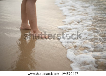 girl stand on the beach - stock photo