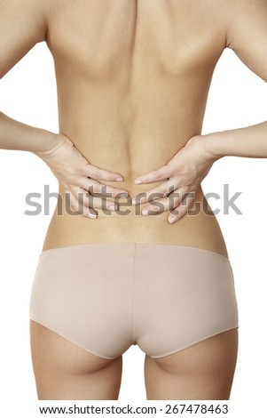 girl standing and massaging sore back - stock photo