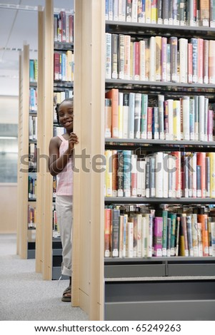 Girl standing in library - stock photo