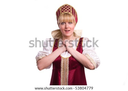 Girl standing in Russian traditional costume. Woman is wearing sarafan and kokoshnik . The girl in red old russian dress. Isolated on white. - stock photo
