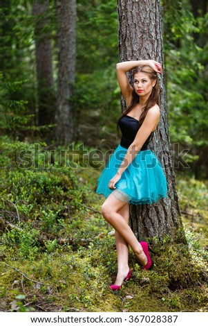 Girl standing near a tree. - stock photo
