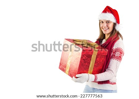 Girl standing while holding a present on white background - stock photo
