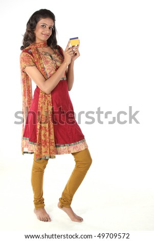girl standing with gold card - stock photo