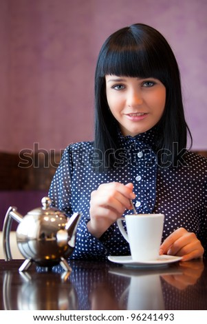 girl stir something in cup - stock photo