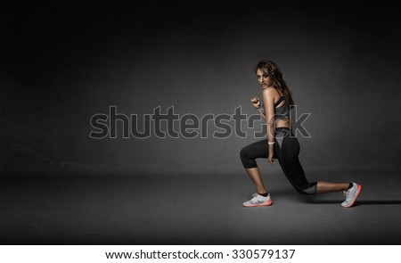 girl stretching legs, abstract room - stock photo