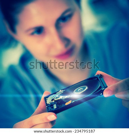 girl student with a hard disk HDD in the hands - stock photo