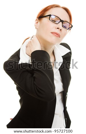 Girl suffering from the pain and massaging her neck - stock photo