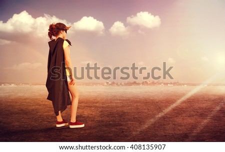Girl superhero on the background of the urban landscape . Girl power concept - stock photo