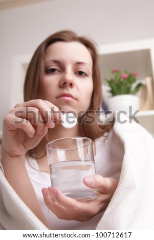 girl takes the pill - stock photo