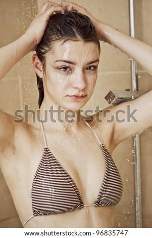Girl taking a shower - stock photo