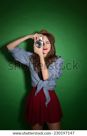 Girl taking photo on retro vintage hipster camera.  - stock photo