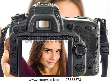 Girl taking selfie from professional camera - stock photo