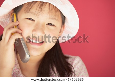 Girl talking on a mobile phone - stock photo