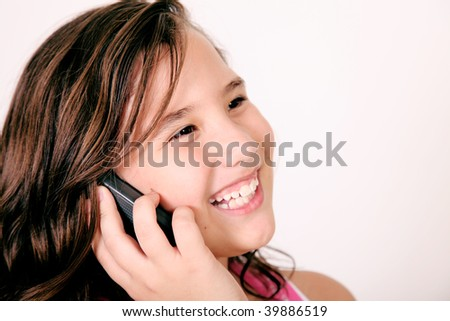 Girl talking on her mobile phone and smiling. Image space to insert your design or text - stock photo