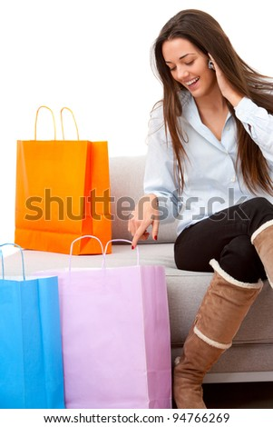 Girl talking on mobile after some shopping. - stock photo