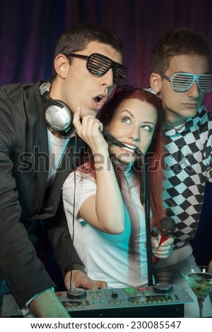 Girl teasing the DJ. - stock photo
