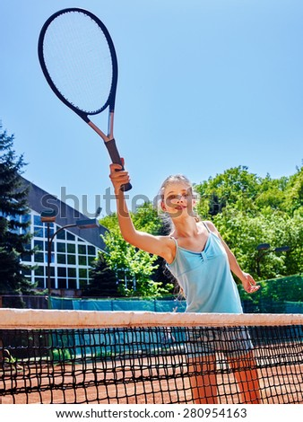 Girl teen sportsman with racket and ball near net on  tennis court.  - stock photo