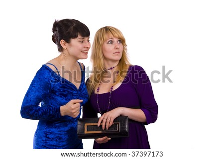 Girl telling a secret to another - gossip isolated over a white background. Woman friends series. Happy young women friends talking and laughing. - stock photo