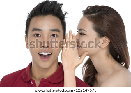 Girl telling secrets to her friend - stock photo