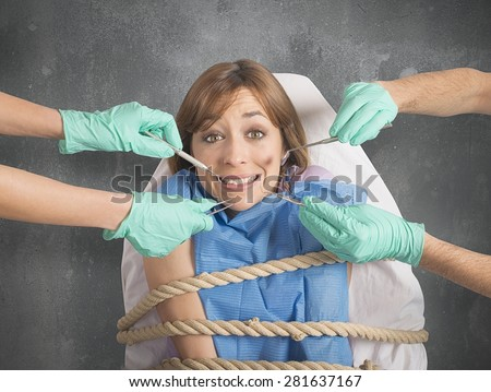Girl tied to a chair at dentist - stock photo
