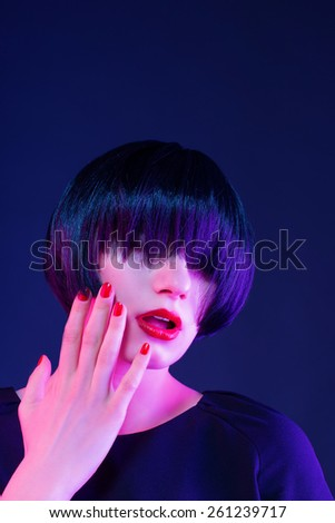 girl touching her face - stock photo