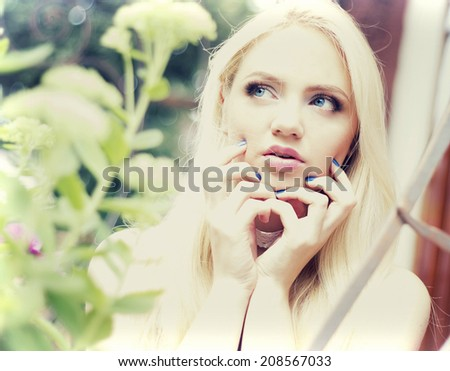 girl touching her face hands - stock photo